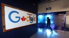 An employee walks at Google Canada's engineering headquarters in Waterloo, Ont., on Jan. 22, 2016. (Cole Burston/Bloomberg)