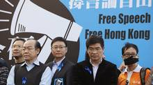 Protesters, including pro-democracy lawmakers, stand in front of a banner during a demonstration demanding for freedom of speech and press freedom in Hong Kong Feb. 23, 2014. (Bobby Yip/Reuters)