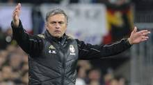 """Real Madrid's coach Jose Mourinho gestures during their Spanish King's Cup quarter-final first leg """"El Clasico"""" soccer match against Barcelona. (FELIX ORDONEZ/Reuters)"""