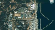 This GeoEye's IKONOS satellite image was taken over the Fukushima Daiichi nuclear power plant in Japan at 10:19 am (Tokyo time) on March 17, 2011 and released to Reuters on March 17. Towers 1, 3 and 4 are clearly distinguishable. (HO/Reuters)