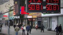 Russia's benchmark index sank 10.8 per cent Monday, with a falling currency causing the country to raise interest rates from 5.5 per cent to 7 per cent. (Alexander Zemlianichenko/AP)