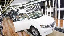 New Lexus vehicles are built on the line at the Lexus plant in Cambridge, Ont., on June 18, 2014. (Peter Power for The Globe and Mail)