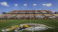 Hamilton Tiger-Cats fans leave the east grandstand following the annual CFL Labour Day Classic against the Toronto Argonauts and the inaugural game at the new Tim Hortons Field in Hamilton, Ont., Monday, September 1, 2014. (Aaron Lynett/THE CANADIAN PRESS)