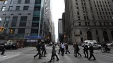 File photos of Toronto's financial district in the King St West and Bay St area. Pedestrians crossing Bay St. at Adelaide St. West. (Fred Lum/Fred Lum/The Globe and Mail)