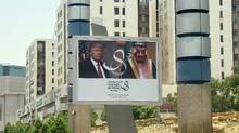 A giant billboard bearing portraits of U.S. President Donald Trump and Saudi Arabia's King Salman is seen on a main road in Riyadh, on May 19, 2017. (FAYEZ NURELDINE/AFP/Getty Images)
