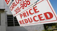 A price reduced sign is seen in front of a home that is for sale on January 6, 2009 in Miami, Florida. (Joe Raedle/2009 Getty Images)