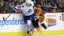 Toronto Maple Leafs' Nikolai Kulemin, left, of Russia, collides with Philadelphia Flyers' Maxime Talbot during the first period of an NHL hockey game on Wednesday, Oct. 2, 2013, in Philadelphia, Pa. Kulemin will miss the next two weeks after suffering an ankle injury in practice on Friday. (MATT SLOCUM/AP)