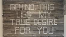 Mark Clintberg, Behind this lies my true desire for you, 2012, Salvaged wood, latex paint, offset print posters, 670 cm x 944 cm.