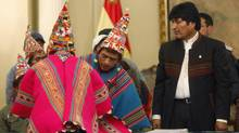 Bolivia's President Evo Morales, right, and Quechua leaders participate in a signing agreement ceremony at which Canada's South American Silver's mining rights were recinded, July 10, 2012. Morales' government and leaders of Quechua Indians in Bolivia's southern highlands reached an agreement for the cancellation and subsequent reversal of the mining concession granted to the Canadian mining company. (Juan Karita/AP)