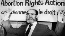Dr. Henry Morgentaler stands in front of banner which reads, Canadian Abortion Rights Action League in 1988. (CP)