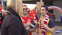 CityNews reporter Shauna Hunt interviews two Toronto FC soccer fans in Toronto on May 10. (CityNews/THE CANADIAN PRESS)