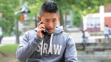 A Toronto student uses his cellphone. (Kevin Van Paassen/Kevin Van Paassen/The Globe and Mail)