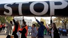 Demonstrators carry a giant mock pipeline while calling for the cancellation of the Keystone XL pipeline during a rally in front of the White House in Washington November 6, 2011. (JOSHUA ROBERTS/JOSHUA ROBERTS/REUTERS)