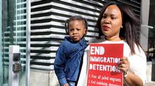 Kimora Adetunji is seen with her son King outside Federal Court in Toronto on May 15, 2017, where a court hearing is being held on indefinite immigration detention. (Colin Perkel/THE CANADIAN PRESS)