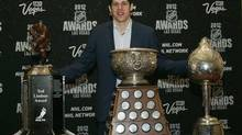 Pittsburgh Penguins' Evgeni Malkin poses with the Ted Lindsay Award (L), the Art Ross Trophy (C) and the Hart Trophy during the 2012 NHL Awards show at the Wynn Las Vegas Resort in Las Vegas, Nevada June 20, 2012. (STEVE MARCUS/REUTERS)