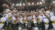 The Alberta Golden Bears poses for a photo with the the University Cup trophy after they defeat the Saskatchewan Huskies in the CIS University Cup hockey final in Saskatoon on Sunday, March 23 2014. The Golden Bears defeat the Huskies 3-1. (Liam Richards/THE CANADIAN PRESS)