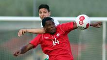 Canada's Cyle Larin, front, challenges for a ball with Ilia Milanov, back, of Bulgaria during a friendly soccer match between Canada and Bulgaria, in Ritzing, Austria, Friday, May 23, 2014. (Ronald Zak/AP)