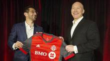 Toronto FC president Bill Manning, right, and general manager Tim Bezbatchenko unveil the team's new shirt for the forthcoming season in Toronto on Feb. 24, 2017. (Chris Young/THE CANADIAN PRESS)