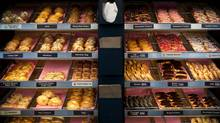 Assorted doughnuts sit in baskets at a Dunkin' Donuts Inc. store in West Orange, N.J. /Bloomberg (Emile Wamsteker/Bloomberg)