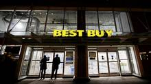 People peer into a closed Best Buy's storefront on Dundas and Bay streets in Toronto, Dec. 25, 2011. (Michelle Siu for The Globe and Mail/Michelle Siu for The Globe and Mail)