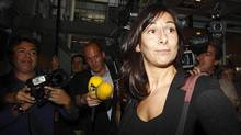 Journalists surround French lawyer Delphine Pando, who represents the French magazine Closer, as she leaves the court in Nanterre, near Paris, on Sept. 17, 2012. (JACKY NAEGELEN/REUTERS)