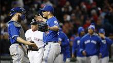 Toronto Blue Jays' Roberto Osuna, second from left, celebrates with Russell Martin after the Blue Jays defeated the Boston Red Sox 4-3 during a baseball game in Boston, Saturday, Oct. 1, 2016. The Blue Jays won 4-3. (Michael Dwyer/AP)