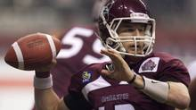 McMaster University Marauders' Kyle Quinlan prepares to throw the ball during the second half of play against the Laval University Rouge et Or's at the Vanier Cup Canadian university football championship in Vancouver, B.C., on Friday November 25, 2011. (JONATHAN HAYWARD/THE CANADIAN PRESS)