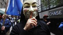 An Occupy Wall Street demonstrator marches around the Chase banking offices near Wall Street in New York October 12, 2011. (SHANNON STAPLETON/Reuters)
