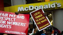 Demonstrators gather outside a McDonald's restaurant in New York, May 15, 2014. (BRENDAN MCDERMID/REUTERS)