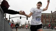 Danielle Rohm gets encouragement from a supporter during the 113th running of the Boston Marathon in Natick, Massachusetts in 2009. (REUTERS/Adam Hunger/REUTERS/Adam Hunger)