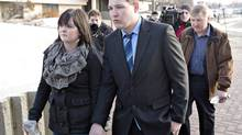 Brenden Holubowich walks with supporters to a courthouse for sentencing in the deaths of four high school football players, in Grande Prairie, Alta., on Tuesday, Feb. 26, 2013. (JASON FRANSON/THE CANADIAN PRESS)