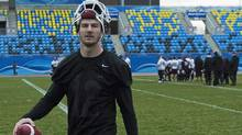 McMaster Marauders quarterback Kyle Quinlan takes practice at Moncton Stadium in Moncton, N.B. (Andrew Vaughan/The Canadian Press)