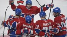Montreal Canadiens' David Desharnais (51) celebrates with teammates Max Pacioretty (67), Andrei Markov (79) Alexei Emelin (74) and Erik Cole (72) after scoring against the Ottawa Senators' during first period NHL hockey action in Montreal, Sunday, February 3, 2013. (Graham Hughes/THE CANADIAN PRESS)