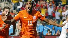 Netherlands' Leroy Fer celebrates scoring the opening goal during the group B World Cup soccer match between the Netherlands and Chile at the Itaquerao Stadium in Sao Paulo, Brazil, Monday, June 23, 2014. (Associated Press)
