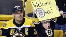 Jake Carr, 5, of Wilmington, Mass., holds up a sign during an NHL hockey scrimmage between the Boston Bruins and the Providence Bruins at TD Garden in Boston, Tuesday, Jan. 15, 2013. (Associated Press)