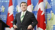 Finance Minister Jim Flaherty talks to media during a lock-up for the federal budget in Ottawa on Tuesday, March 22, 2011. (Adrian Wyld/Adrian Wyld/The Canadian Press)