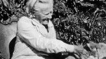 Parks Canada has unveiled a plaque in Princeton, B.C., honouring pioneer woman and poet , Susan Allison. She is shown playing with a pet coyote , Synkelips, which is the Chinook language word for coyote. (Princeton Museum/ The Globe and Mail)