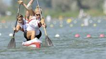 Canada's Laurence Vincent-Lapointe, front, and Mallorie Nicholson, back, paddle to win the 500 meters C2 women's final race at the Canoe Sprint World Championships in 2011. Today's topics: Female canoe racers and Olympic-sized discrimination; ganging up on violence in Toronto; turning to Russia for help in Syria; CEOs' non-retirement ... and more (Bela Szandelszky/The Associated Press)