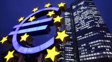 The Euro sculpture is seen in front of the European Central Bank in Frankfurt, central Germany, in this Nov. 30, 2005 file photo. (MICHAEL PROBST/AP)