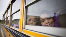 Public school enrollment in Masset, B.C. is decreasing, while Chief Matthews School – which is growing popular because it offers Haida language classes – has a waiting list for kindergarten through Grade 4. In this Oct. 3, 2012 photo, Native children are leaving Chief Matthews by bus. (John Lehmann/The Globe and Mail)