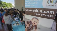 People sign up for health insurance information at a California event marking the opening of the state's Affordable Healthcare Act, commonly known as Obamacare. (LUCY NICHOLSON/REUTERS)
