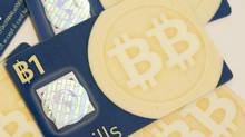 Bitbills, a physical representation of the virtual currency Bitcoin, in Amherst, Mass., June 30, 2011. A rise in value of the digital currency that began in January 2013 has experts questioning whether the rise is real value or evidence of a bubble. (Nancy Palmieri/NYT)
