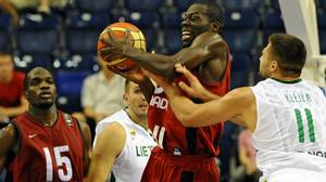 Canada's Denham Brown (C) grabs the ball away from next to Lithuania's Linas Kleiza during their preliminary round game between Lithuania to Canada at the FIBA World Basketball Championships in Izmir, Turkey on August 29, 2010. Getty Images / FRANCK FIFE