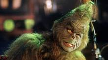 Jim Carrey, dressed as the Dr. Seuss storybook character Mr. Grinch, appears in a scene from the movie adaptation of The Grinch Who Stole Christmas. (AP)