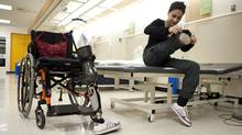 Bushra Saeed works through her daily physiotherapy routine at the Rehabilitation Centre in Ottawa. (Sean Kilpatrick/Sean Kilpatrick/The Canadian Press)