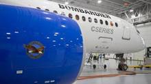 Bombardier's CS300 Aircraft, showing its Pratt & Whitney engine in the foreground, sits in the hangar prior to its test flight in Mirabel on Feb. 27, 2015. (Christinne Muschi/Reuters)