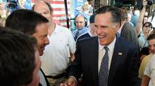 Former Massachusetts Gov. and Republican presidential hopeful Mitt Romney (R) greets supporters after speaking about his plan to increase jobs and boost the U.S. economy at McCandless International Trucks, Inc. September 6, 2011 in North Las Vegas, Nevada. (Ethan Miller/Getty Images/Ethan Miller/Getty Images)
