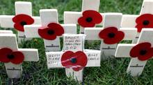 Crosses and poppies are seen in the Field of Remembrance outside Westminster Abbey in London November 7, 2011. (SUZANNE PLUNKETT/Reuters)