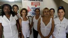 Leader of the dissident group Ladies in White, Berta Soler, left, poses with members of the group at the home of deceased leader Laura Pollan, in Havana March 19, 2012. (ENRIQUE DE LA OSA/REUTERS/ENRIQUE DE LA OSA/REUTERS)
