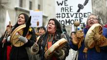 Protestors march toward Parliament Hill during an Idle No More protest in Ottawa, in this January 11, 2013 file photo. (Dave Chan For The Globe and Mail)